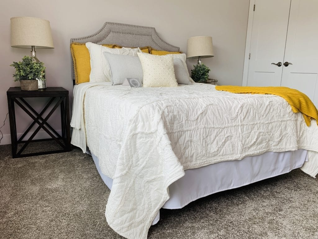 Modern bedroom with tan carpeting