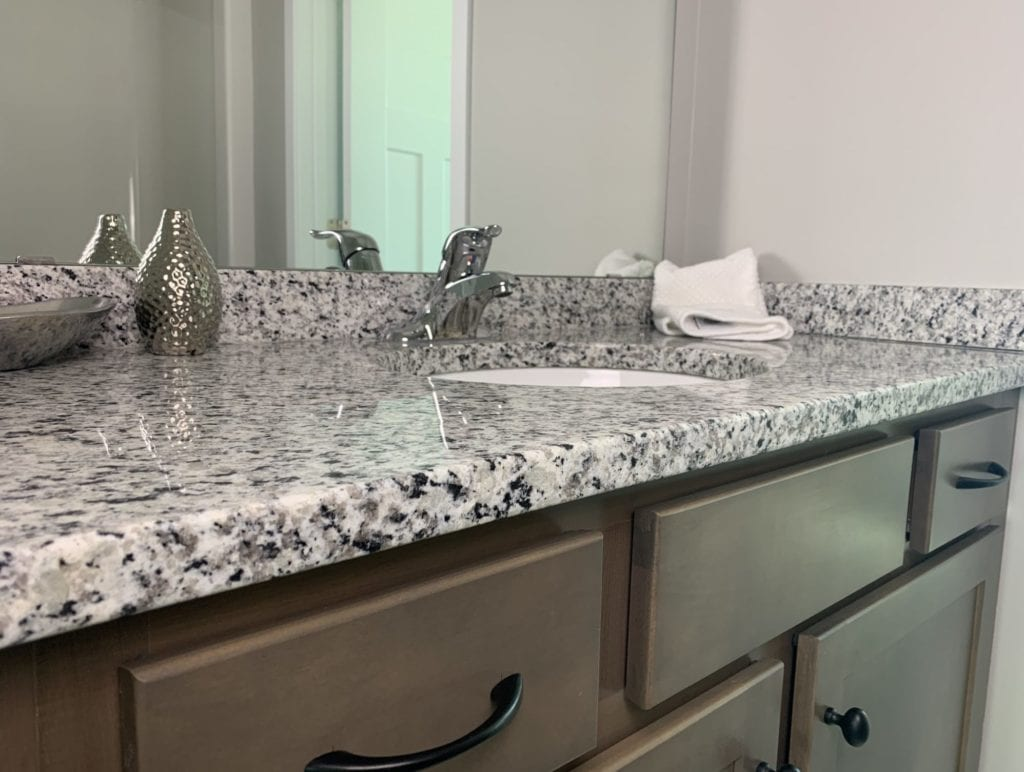 Bathroom vanity with black and white granite countertop